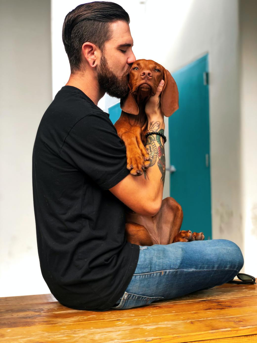 photo-of-man-kissing-his-dog-2745151